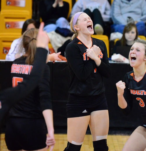 The Tigers celebrate advancing to the NAIA Volleyball National Championship final site. Photo by Ray Muha