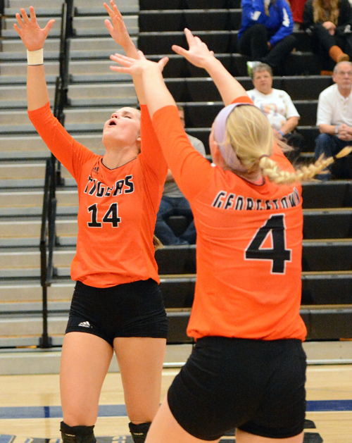 Kaysie Massie and Caroline Ricks celebrate a point during the semifinal match win. Photo by Richard Robards