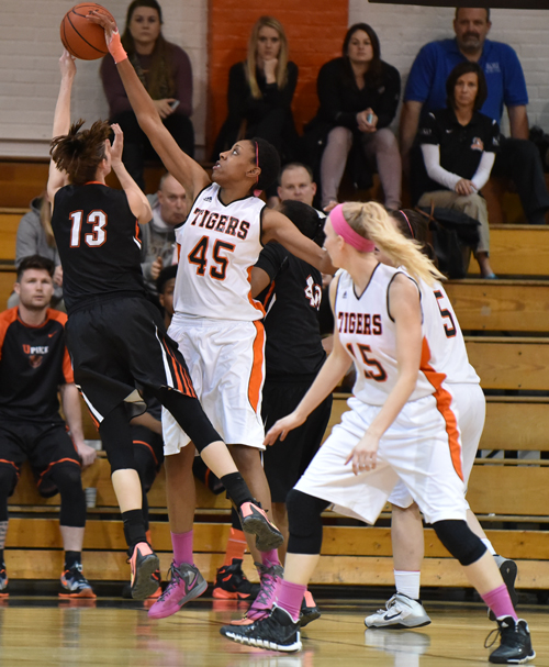 Teonia McCune rejects a Pikeville shot. She had five blocks in the win. Photo by Richard Davis