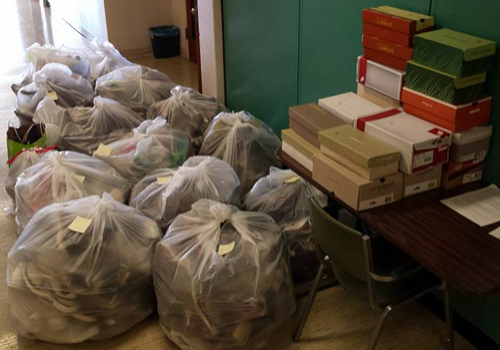 Cross country teams collect 500-plus pairs of shoes for donation and charity.