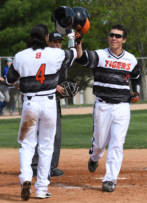 Nick Giambalvo and Sam Medina celebrate a two-run home run. Photo by Richard Davis