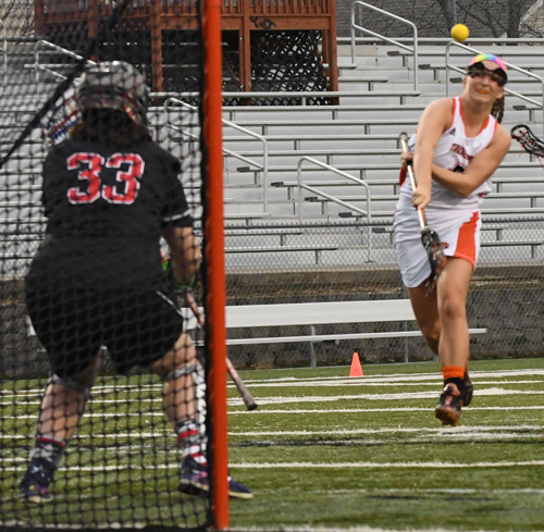 Merrisa Heraldson nets one of her six goals Tuesday. Photo by Richard Davis