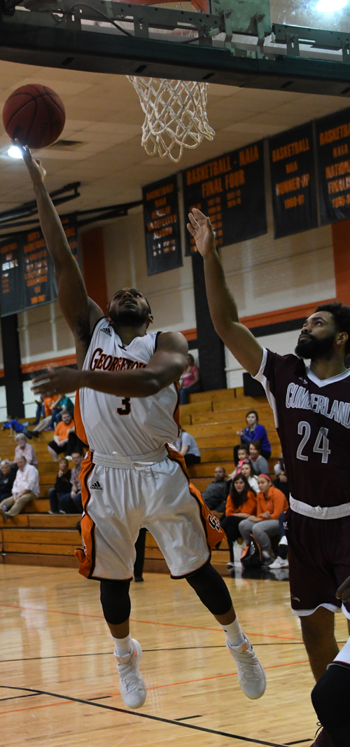 Darion Burns drives to the hole for two. Photo by Richard Davis