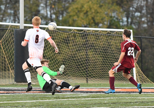 Matthew Oster makes a challenge save. Photo by Richard Davis