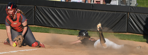 Chelsae Osborn slides safely, scoring the winning run Tuesday. Photo by Richard Davis