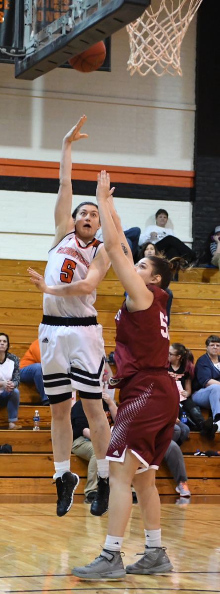 Emilie Ziese goes up for two of her 14 points. She added 20 rebounds as well. Photo by Richard Davis