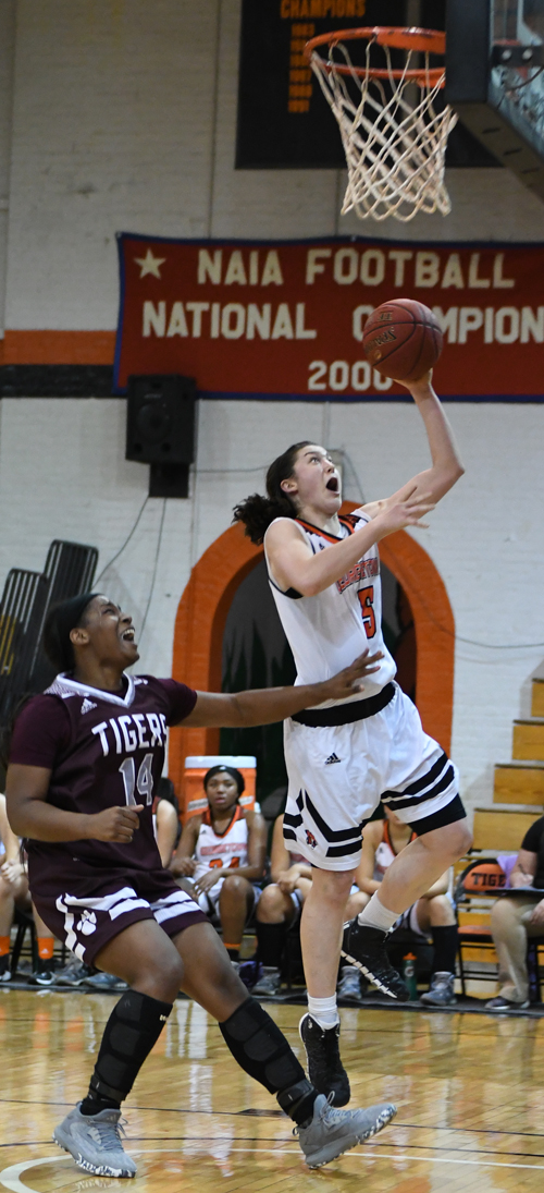 Emilie Ziese runs the floor and scores two on fast break. Photo by Richard Davis