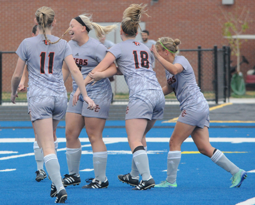 Cassidy Hatfield (18) celebrates her second goal with teammates.