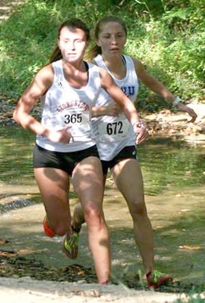 Julia Manning emerges out of the creek Saturday. Photo by Shannon Godar