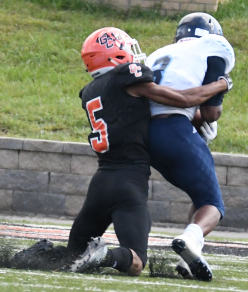 CJ Williams makes a touchdown saving tackle of Charles Ducksworth. Photo by Richard Davis