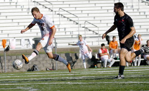 Nick Gregory flicks on the winning shot Saturday. Photo by Richard Davis