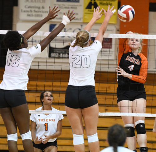 Caroline Ricks puts down one of her 10 kills Friday. Photo by Richard Davis