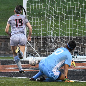 Bethany Massey scores the winning goal Wednesday against Rio Grande. Photo by Richard Davis