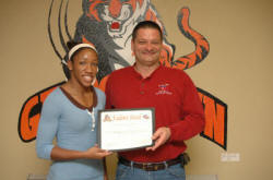 Georgetown College's Mandi Boykin with Larry Cassity of The Hockensmith Agency.