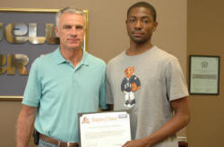 Coldwell Banker McMahan's Carl Tackett with Georgetown College's Teshawn Byron.