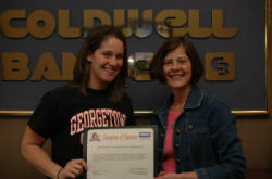 Georgetown College's Devon Golden and Coldwell Banker McMahan's Kim Kearns.