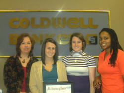 Leandra Jenkins of Coldwell Banker McMahan and Georgetown College's Kendall Lawson, Pamela Hardesty and Ausha Weathers.