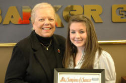 Ann McDonald of Coldwell Banker McMahan and Georgetown College's Megan Melanson.