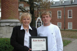 Paula Gibson of The Hockensmith Agency with Georgetown College's Austin Moman.