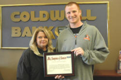 Brenda Perry of Coldwell Banker McMahan with Georgetown College's Kyle Saxton