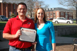 Mike Inman of Coldwell Banker McMahan and Georgetown College's Jessica Waddle.